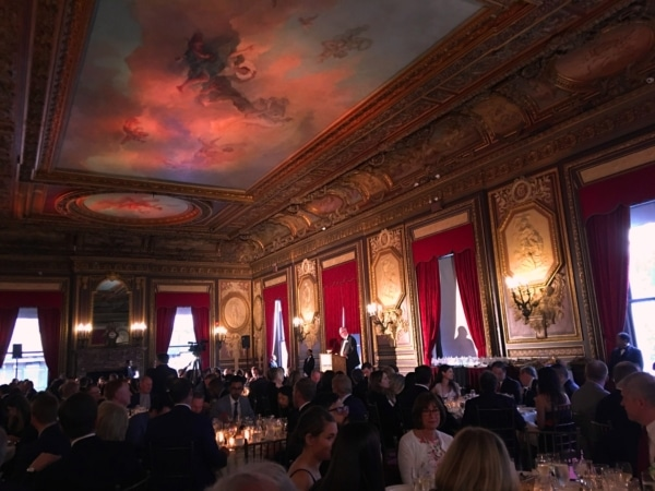 New York City Ballroom with painted ceiling and artwork on walls. People dining at tables.